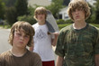 Three teenage brothers 13-17 standing on street, portrait