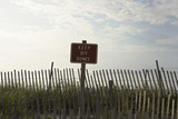 Fence and sign reading 'keep off dunes'