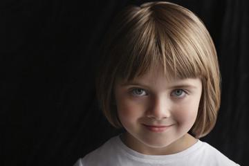 Girl 5-6 on black background, portrait, close-up