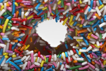 Rainbow sprinkles on doughnut, close-up