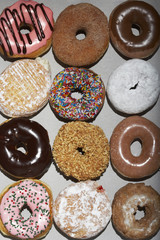 Variety of doughnuts in cardboard box, view from above