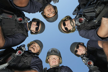 Group portrait of Swat officers standing in circle
