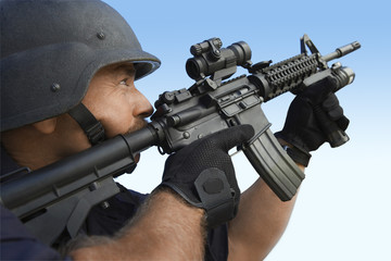 Swat officer aiming gun