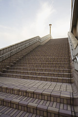 Japan, Tokyo, Ueno JR Station, man on top of steps