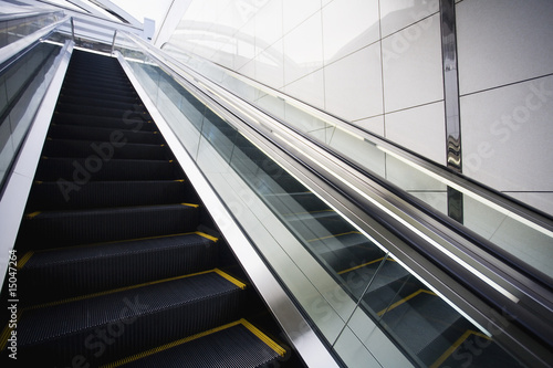 Japan, Osaka, JR Station, man on top of escalator