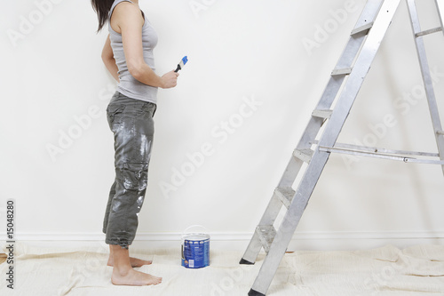 Woman ready to paint wall, low section