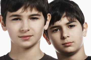 Twin boys 13-15, close-up, portrait