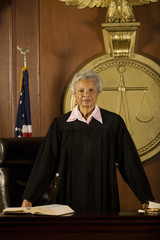 Female judge standing in court, portrait