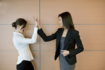 Businesswomen doing high five