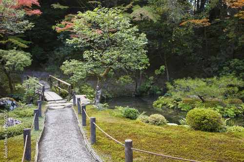 Japan, Kyoto, Tenju-an Temple garden with footpath and bridge