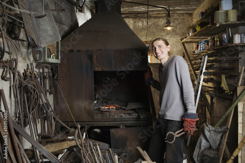 Blacksmith Standing by Forge