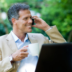 Healthy businessman working outdoor