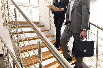 Business people on office staircase