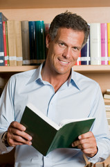 Mature man in library