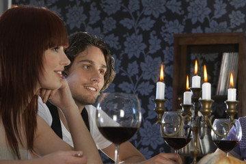 Couple sitting at dining table, close up