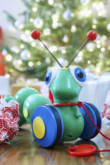 Toy alien in front of Christmas tree
