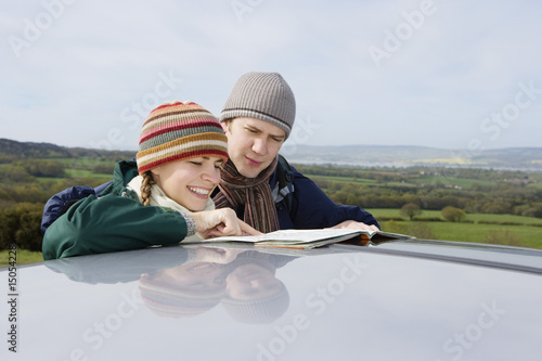 Couple Consulting a Map