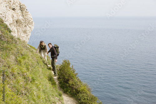 Couple Hiking on a Path Above the Water