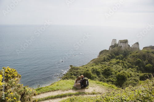 Couple Sitting on an Outlook Above the Water