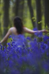 Woman Running Through Flowers