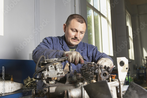 Mechanic Working on Motor