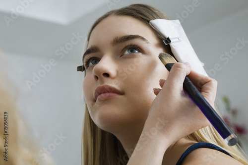 Model Having Makeup Applied