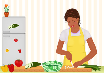 African Woman cooking salad in the kitchen
