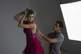 Designer Adjusting Dress Back on Fashion Model