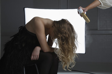 Fashion Model Having Hair Sprayed at Photo Shoot