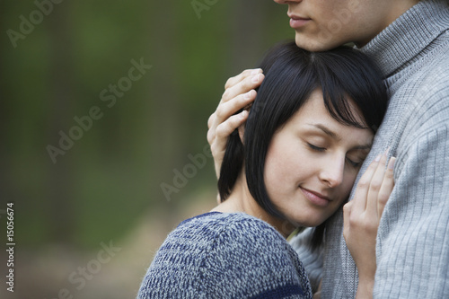 Young Woman Laying Head on Chest of Young Man