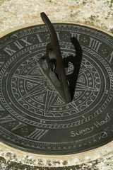 sundial close-up at three in the afternoon