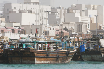 dubai uae dhows old wooden sailing vessels are docked along the deira side of dubai creek.