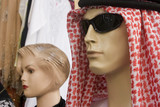 dubai uae mannequin display of traditional men's headdress gutra at shop in bur dubai