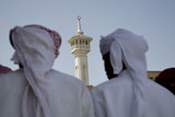 UAE, Dubai, group of traditionally dressed Muslim men perform a song for visitors to the Bastakia
