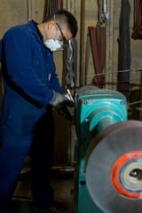 Polishing metal in workshop