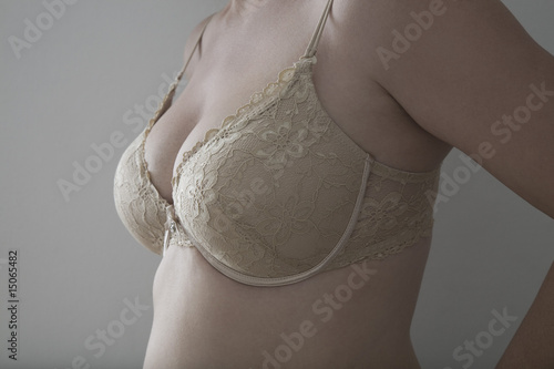 Detail of woman's breasts in bra