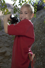 Boy 7-9 using binoculars