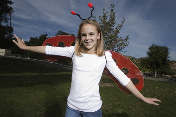 Portrait of girl 10-12 wearing ladybug costume
