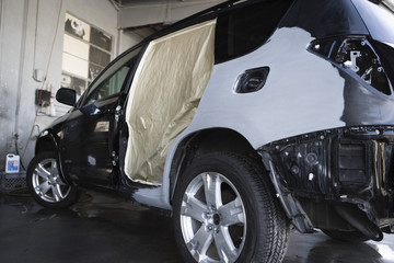 Damaged sports utility vehicle in garage