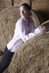 Girl relaxing in barn