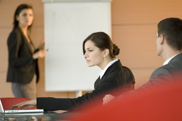 Businessman and woman at a presentation
