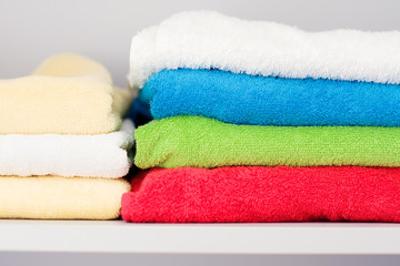 Colorful towels in the closet