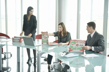 Business people with pizza boxes at desk