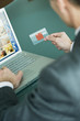 Businessman holding credit card at laptop