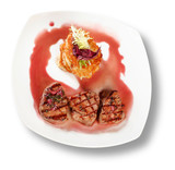 Veal Medallions with potato pancakes. Closeup. File includes cli poster