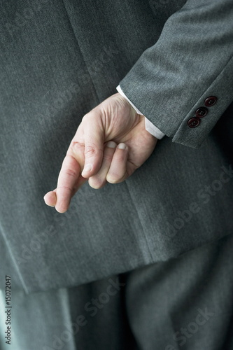 Businessman's fingers crossed