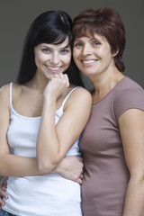 Studio portrait of young woman with mother