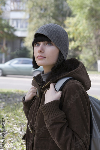 Young woman at street in winter clothing