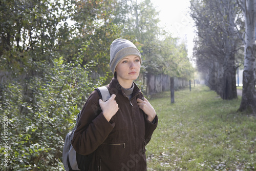 Young woman in winter clothing at park
