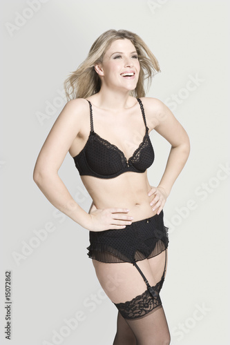 Sexy young woman in underwear, laughing